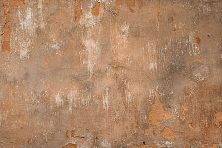 Shabby old wall with peeling paint concrete textured backdrop background brown gray
