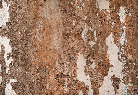 Shabby wall with peeling paint concrete textured backdrop background