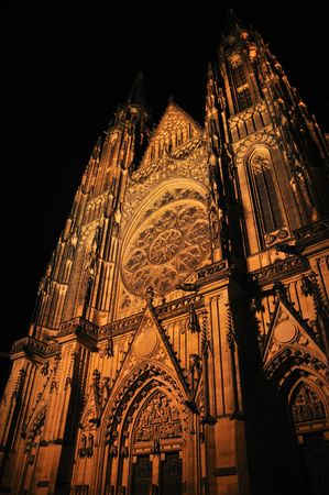 St. Vitus cathedral in Prague at night, Czech republic - large and majestate gothic building. photo