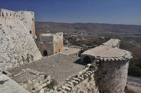 Krak des Chevaliers, transliterated Crac des Chevaliers, is a Crusader fortress in Syria and one of the most important preserved medieval military castles in the world. photo