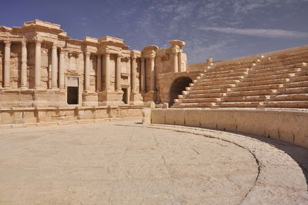 The second most noteworthy remain in Palmyra is the theater, today having 9 rows of seating, but most likely having up to 12 with the addition of wooden structures. It has been dated to the early 1st century AD. Stock Photo