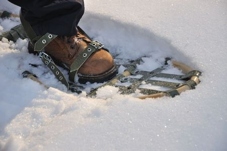 snowshoes - you can walk on snow with them. Stock Photo
