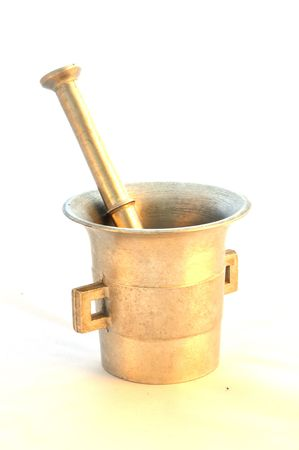 Isolated, old mortar like made of gold from grandmother. Stock Photo - 6695474
