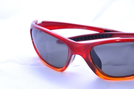 Red sunglasesses for sport activity with polarized lenses, isolated on white. Stock Photo - 7461954