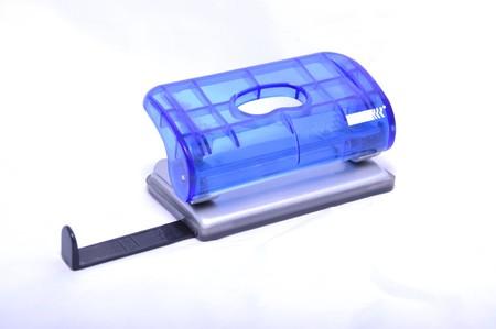 Blue office punching machine, isolated on white background. Stock Photo - 7461951