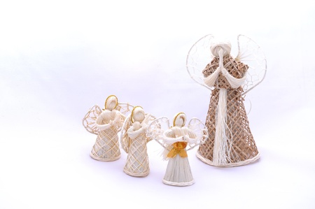 White Christmas straw angels ornament isolated on white background. photo