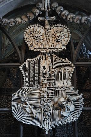 Family emblem of Schwarzenberg made of bones in Sedlec Ossuary, Kutna Hora, Czech Republic   photo