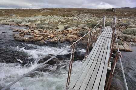 Hardangervidda in summer time, the bridge over the riverr  Norway