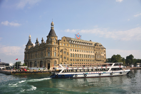 Haydarpasha train station Istanbul and boat,  photographed from water