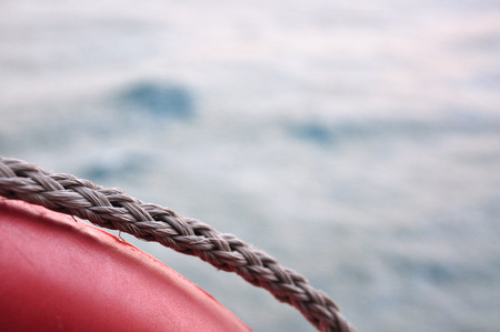 Red life buoy on sea background photographed from a boat