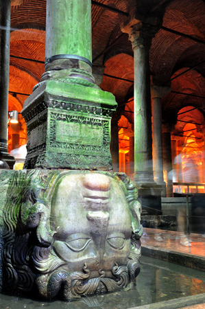 The upside down head of Medusa, propping up a column in the Basilica Cistern in Istanbul. Stock Photo