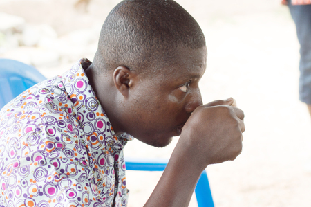 refreshes: young man drinking palm wine.