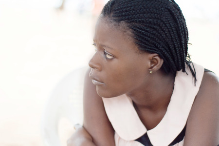looking aside: young woman looking aside. Stock Photo