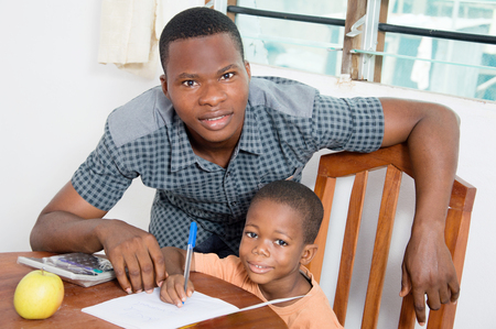 age 5: Studying Schoolboy With His home teacher.