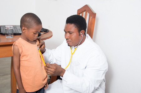 Health professional examining a child.