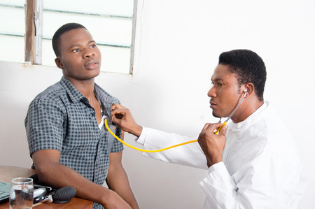 africa: Doctor examining a patient.