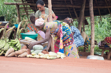 wares: akoup, Ivory coast-august 20.2015: sellers of food products display Their wares at roadside for sale