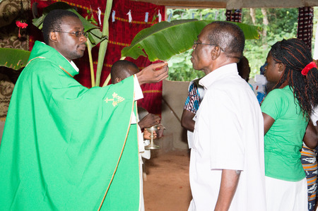 cassock: Mass at church in the village. Editorial