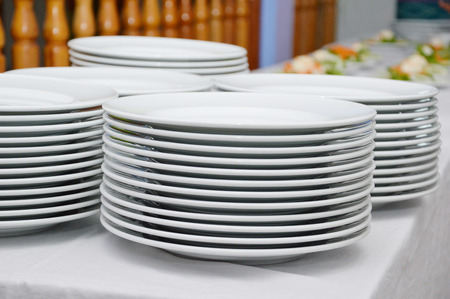 serf: Stack of saucers. Stock Photo