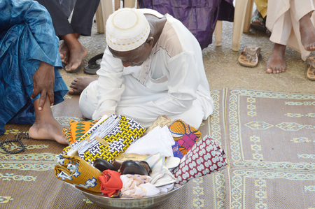 scarves: Abidjan, Ivory coast - February 26, 2015: does a traditional wedding ceremony in Abidjan, a bowl full of cloths, shoes and scarves to Accompany the bride to her future husband. Editorial