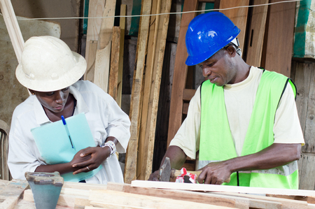 congratulating: The teacher congratulating His student in carpentry With That beautiful smile. Stock Photo