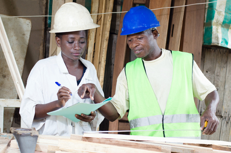 dictate: The carpenter trainee ? son dictate what she must write. Stock Photo