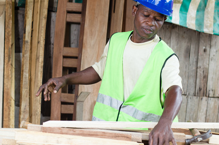 work materials: This carpenter spread His work materials on the table.
