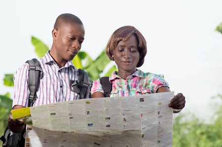 identify: These young people read a map of the country to Identify Their Place of arrival.