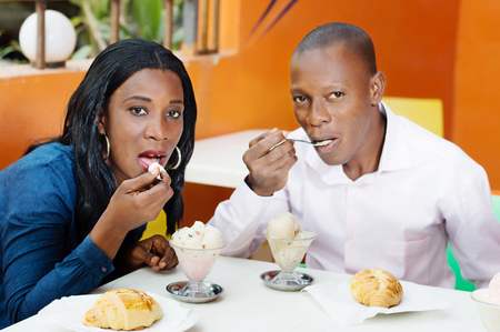 young couple have lunch together at the restaurant.