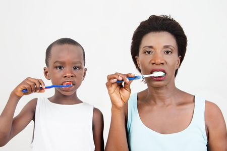 mother and her child brush Their teeth together Each morning.