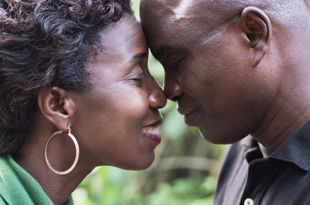 Closeup of a romantic couple face to face and embracing in campaign. Banque d'images