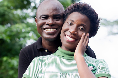 Portrait of happy young couple in love in the countryside.