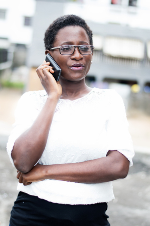 Portrait of young woman talking on the phone.