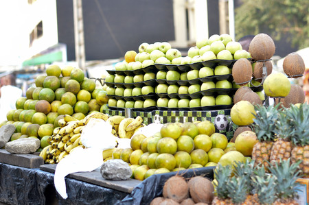 Selling variety of fruits on shelves at the street market. Banque d'images