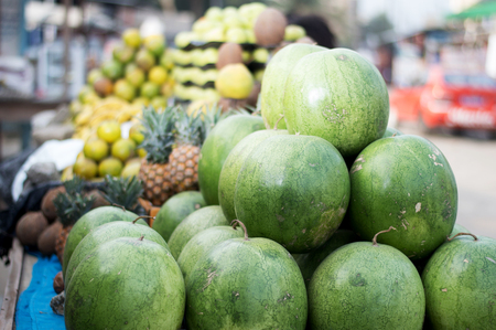 Selling variety of fruits on shelves at the street market. Stock Photo