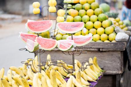 Fresh fruit on shelves at the street market.