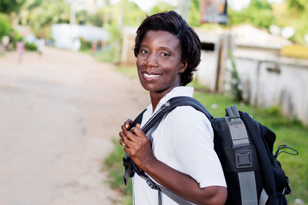 Travel, tourism - smiling young woman with backpack ready to hit the road.