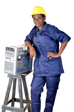 Young woman smiling in uniform standing, elbow on a desktop disassembled Banque d'images - 111828781