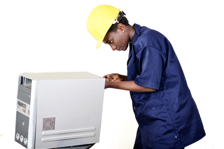 Young African woman in computer maintenance opens the central unit with a turning Banque d'images - 111828783