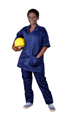 Young smiling construction worker holding his helmet on a white background. Banque d'images - 111828786