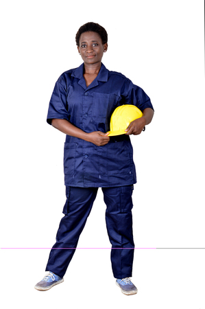 Young construction worker holding his helmet on a white background. Banque d'images - 111828788
