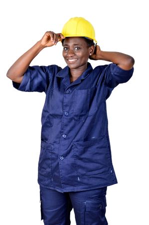 Construction worker wearing her helmet and smiling on a white background. Banque d'images - 111828792
