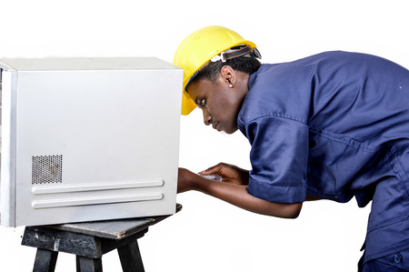 Young African woman in computer maintenance opens the central unit with a turning Banque d'images - 111828801