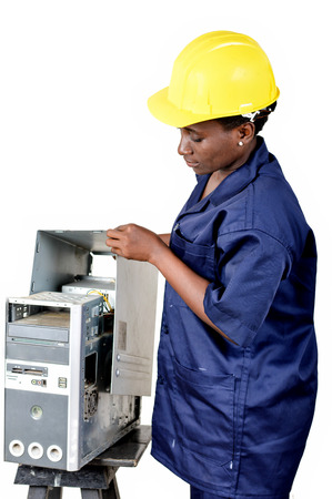 Young female computer maintenance worker checks the status of a computer CPU. Banque d'images - 111828805