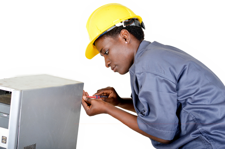 Young woman does the maintenance of a computer by disassembling it with a turn vice Banque d'images - 111828827