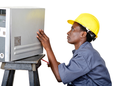 Close-up of a young woman doing the maintenance of a desktop computer. Banque d'images - 111828828