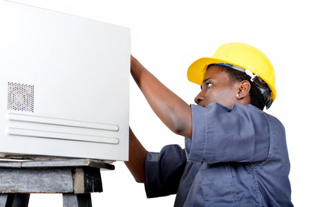 Close-up of a young woman doing the maintenance of a desktop computer. Banque d'images - 111828829