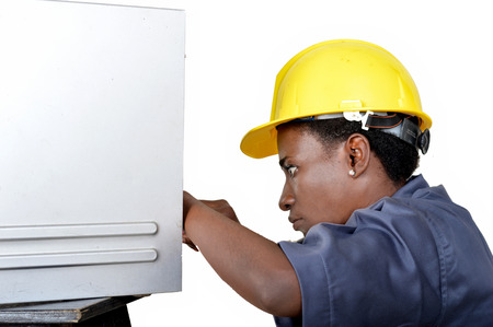 Close-up of a young woman doing the maintenance of a desktop computer. Banque d'images - 111828830