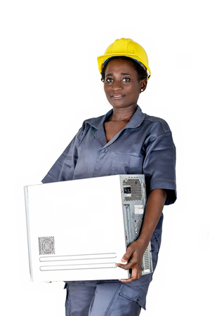 Young computer maintenance woman raises a computer CPU to go and do her maintenance in her workshop Banque d'images - 111828837