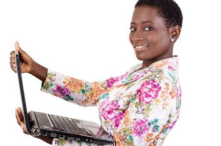 This young businesswoman loves to work with her laptop everywhere as it is very convenient